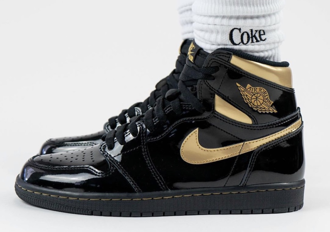 Air-Jordan-1-Black-Gold-555088-032-Release-Date-On-Feet-1